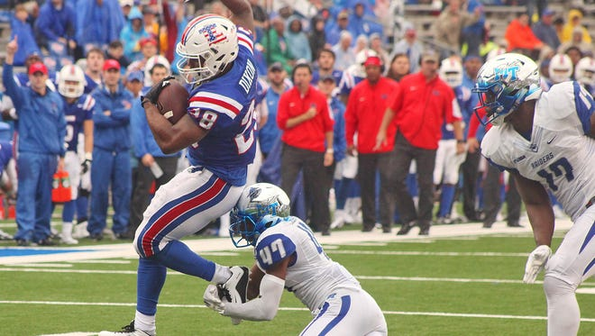 Louisiana Tech running back Kenneth Dixon said he still needs to knock the rust off but his health was good enough to score four touchdowns against Middle Tennessee.