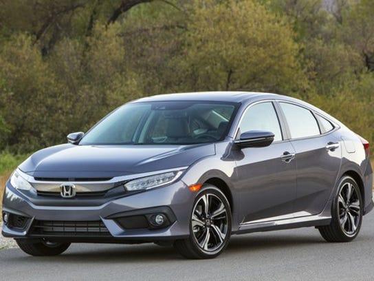 A gray Honda Civic, a compact four-door hatchback.