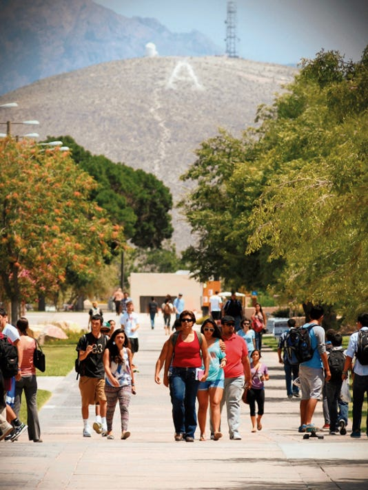 Darren Phillips Photo   New Mexico State University students walk along the International Mall on the first day of class instruction in Las Cruces, N.M..