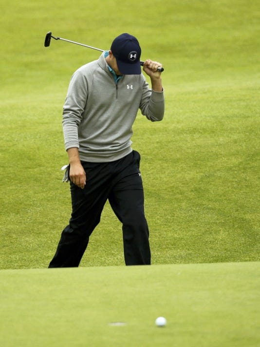 United States' Jordan Spieth reacts after missing a putt on the 18th green in the final round at the British Open Golf Championship at the Old Course, St. Andrews, Scotland, Monday, July 20, 2015.