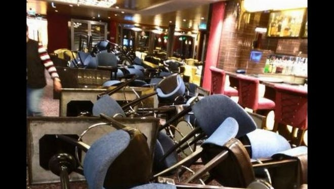 Furniture is toppled after Royal Caribbean Anthem of the Seas hit rough weather.