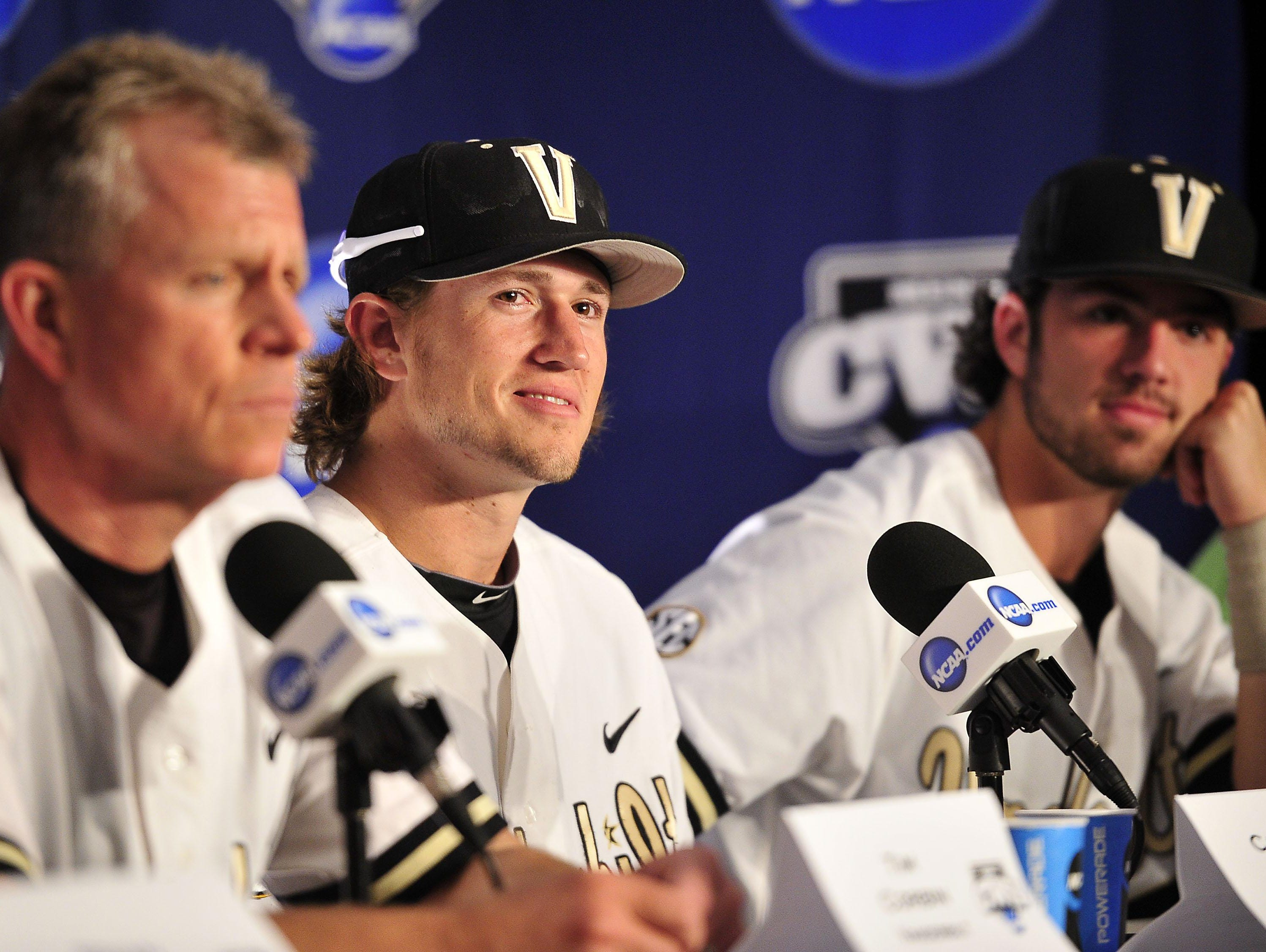 Vanderbilt coach Tim Corbin and Commodores stars Carson Fulmer, center, and Dansby Swanson await questions at a news conference Sunday at the College World Series. Swanson, the No. 1 overall pick in the pro baseball draft, and Fulmer, who was picked eighth, say they are focused on finishing their college careers, not what lies ahead in pro ball.