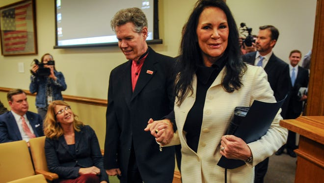 Randy Travis holds his wife Mary's hand as they enter the committee room to make a presentation to the Health and Welfare Committee on Tennessee Stroke Awareness Day on the Hill Wednesday Feb. 8, 2017, at the Legislative Plaza in Nashville, Tenn.