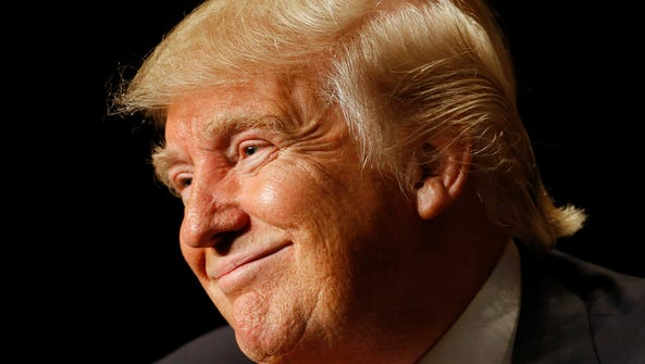 Republican presidential candidate Donald Trump smiles