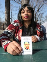 Cathis Johnson poses with a photo of her son, Caval Haylett Jr., at College Hill Park in Poughkeepsie, on March 6, 2017. Caval was shot on March 9, 2016 and died a day later.