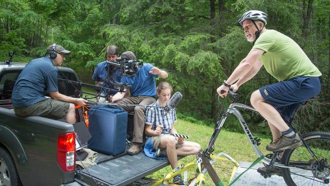 Dr. Robert Barker and the crew from Säntis Creative Group film in Laurel Ridge development.
