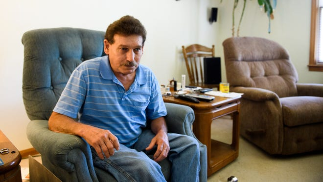 Jim Lankford sits inside his home on Wednesday, June 6, 2018. Lankford, who has had multiple knee, back and neck surgeries due to injuries and a degenerative joint disease, says he isn't as active or social as he used to be because of the constant pain he endures daily.