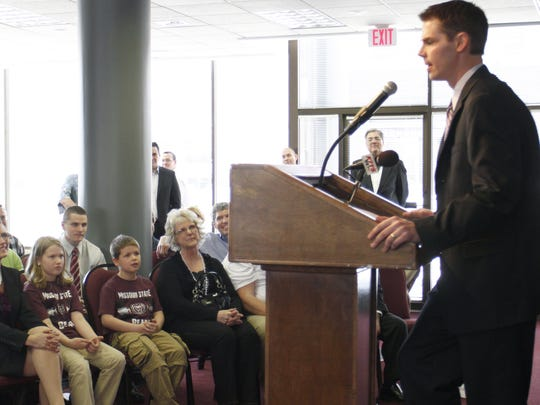 Paul Lusk, new basketball coach at Missour State speaks while his wife Melanie, daughter Madison and son Jackson listed during a press conference at the Meyer Alumni Center on Saturday, April 2, 2011. Nathan Papes/News-Leader