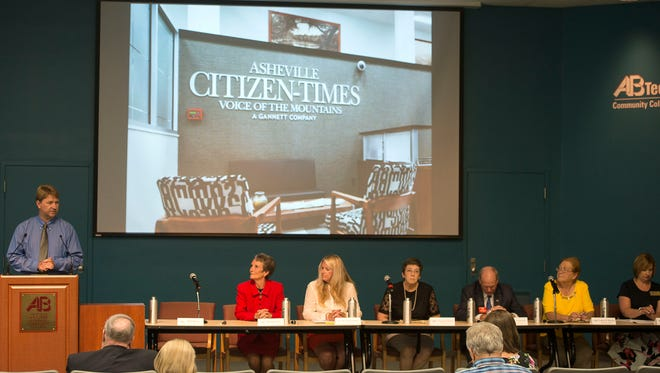 Matt Kern, Donna Pate, Amy Smith Wamsley, Peggy Buchanan, Robert ÒBobÓ Chilmonik, Mark Crawford, Amy Churchill and Laura M. Bowen discuss public education at the candidate forum for the Buncombe County Board of Education Aug. 25, 2016 at Ferguson Auditorium on the A-B Tech campus.