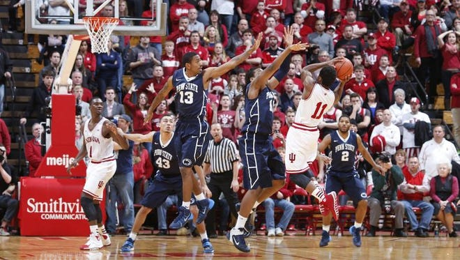 IU's Yogi Ferrell attempts a last-second, game-winning shot in Wednesday's loss at Penn State. Geno Thorpe, No. 13, and Brandon Taylor, No. 10, were defending.