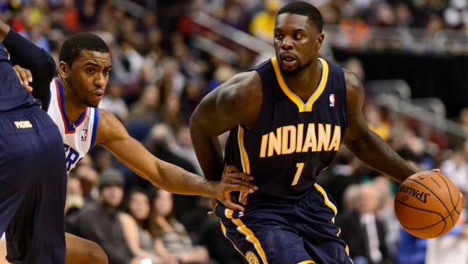 Indiana Pacers guard Lance Stephenson (1) is defended by Philadelphia 76ers forward Hollis Thompson (31) during the second quarter at the Wells Fargo Center.