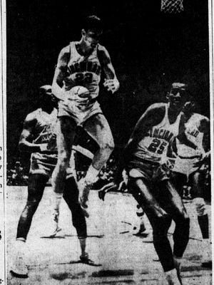 TAKES REBOUND - Cincinnati's Rob Krick gathers a rebound in first period action in Friday's Mid-West Regional playoff in Lubbock, Tex. The Miners came from behind to nip the Bearcats 78-76 in overtime play. Bearcat Roland West (25) gets out of the way. In the background is Miner David Lattin (42).