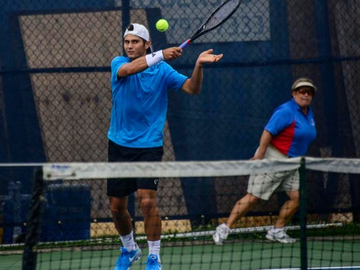 Marcos Giron returns the ball in a match against Takanyi Garanganga during Tuesday'??s Levene Gouldin & Thompson Tennis Challenger at Recreation Park on Tuesday.