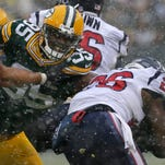 Packers' defense draws line in the snow