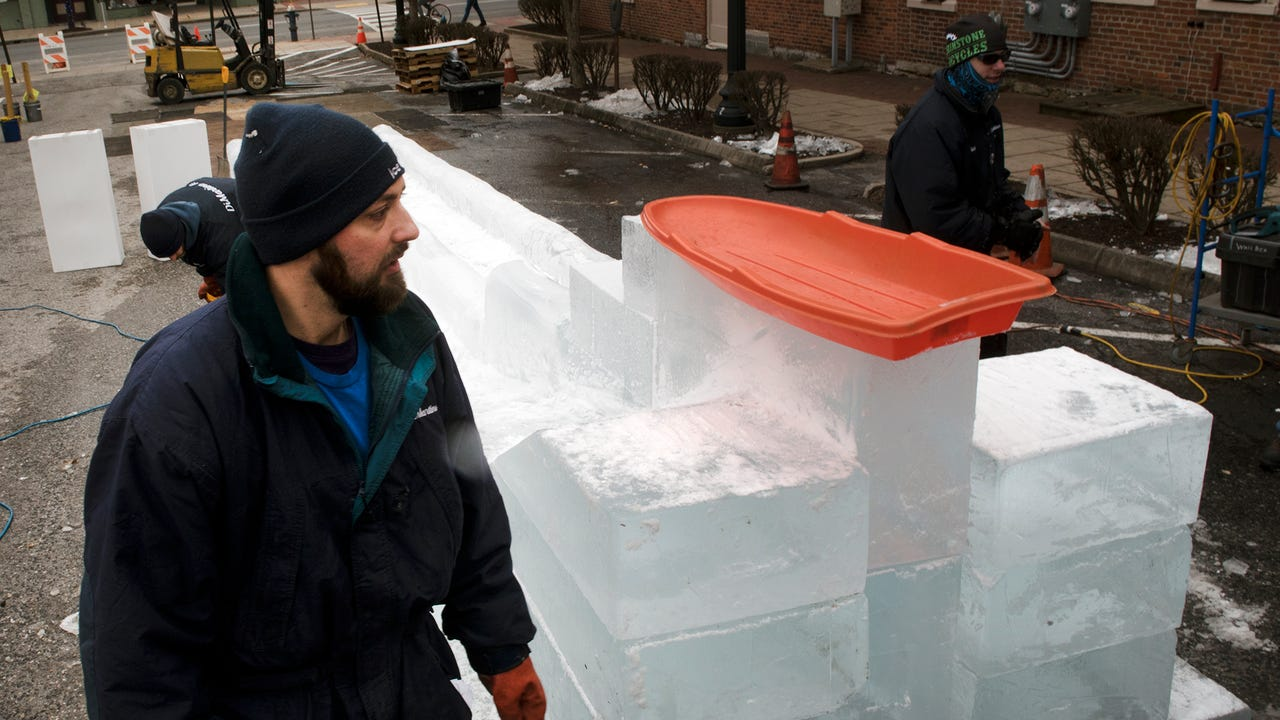 Workers from DiMartino Ice Company carve blocks of ice into the 40-foot-long, double-wide ice slide. The slide will be open at IceFest, 5-8 p.m. Thursday and Friday (Jan. 25,26), 10 a.m. to 8 p.m. Saturday (Jan. 27) and noon to 4 p.m. Sunday (Jan. 28)
