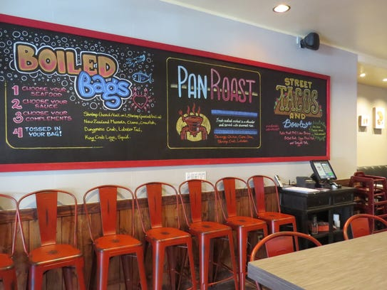 The chalkboard menu at Coconut Crab in Ventura announces
