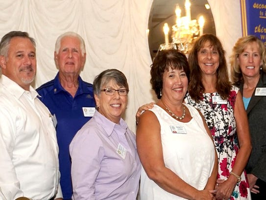(From left) New Vineland Rotary Club member Al Fisher,