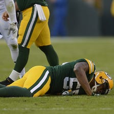 Green Bay Packers linebacker Andy Mulumba (55) lays motionless on the ground after getting injured against the New York Jets during Sunday's game at Lambeau Field.