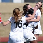 The West Lauderdale Lady Knights mob teammate Riley Thompson after she scored the first goal of the game against Lafayette on Saturday, February 6, 2016, at the MHSAA Soccer Championships at Madison Central High School in Madison, Miss.