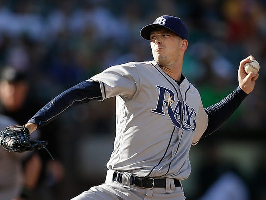 Tampa Bay Rays pitcher Drew Smyly works against the Oakland Athletics in the first inning of a baseball game Saturday, July 23, 2016, in Oakland, Calif. (AP Photo/Ben Margot)