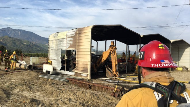 Crews put out a fire inside a carport that burned at least two vehicles Friday afternoon near Santa Paula.