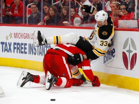 636535496593311250-AP-Bruins-Red-Wings-Hockey-M-1-.jpg