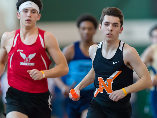 Northville junior Brandon Kearney (right), at a meet