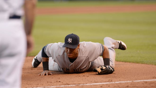Yankees third baseman Yangervis Solarte  can't make a play on a line drive hit by the  Royals' Norichika Aoki in the sixth inning of Saturday night's game at Kauffman Stadium.