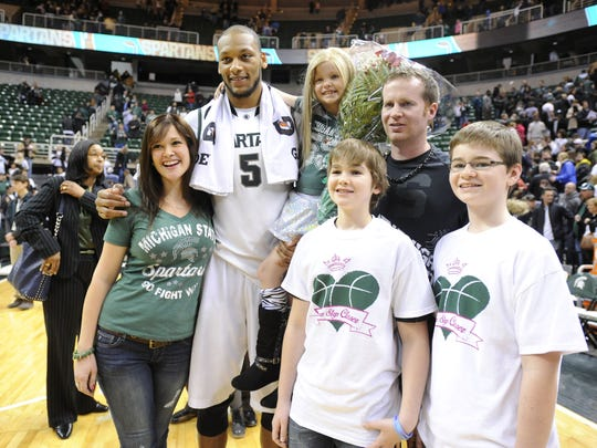 MSU senior Adreian Payne poses with Lacey Holsworth,