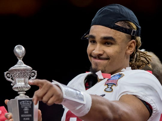 Alabama quarterback Jalen Hurts (2) is presented the