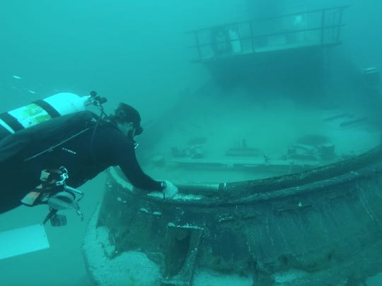 Public works employees in St. Lucie County, Floria sink a tugboat in 2016 to create an artificial reef.