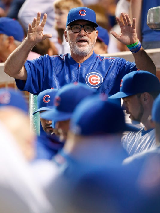 Chicago Cubs manager Joe Maddon talks to his team before a baseball game against the Atlanta Braves on Thursday, July 7, 2016, in Chicago. (AP Photo/Nam Y. Huh)
