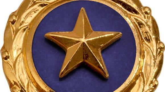 The Gold Star emblem.