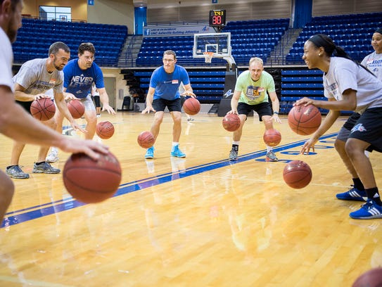UNCA point guard Ja'Da Brayboy leads a dribbling exercise