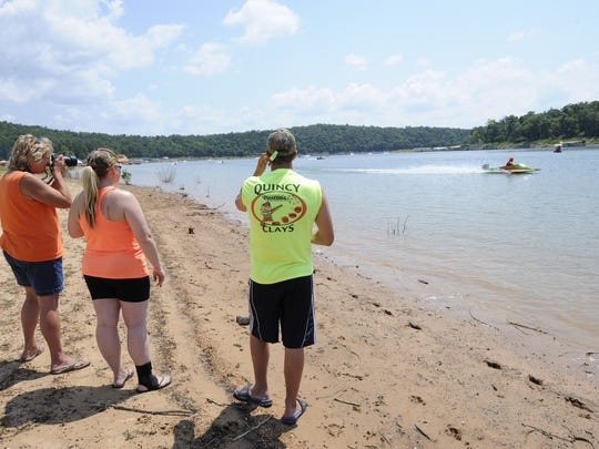 Spectators watch the elimination round of the E Hydroplane class on Saturday at Pigeon Creek.
