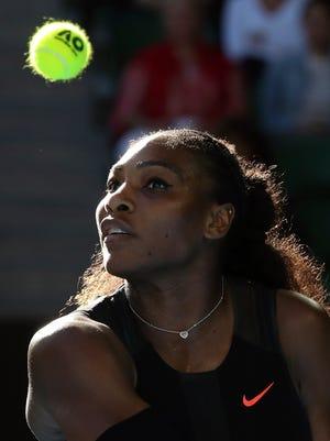 Serena Williams makes a backhand return to Croatia's Mirjana Lucic-Baroni during their semifinal at the Australian Open tennis championships in Melbourne, Australia, Thursday, Jan. 26, 2017.