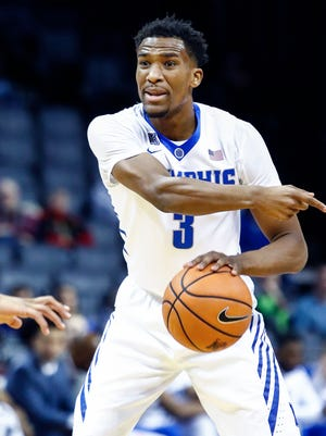 Memphis guard Jeremiah Martin (right) directs teammates against Tulsa during first half action.