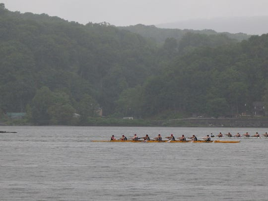 High school crew eights take part in the Row for the Cure event on the Hudson River on Sunday.