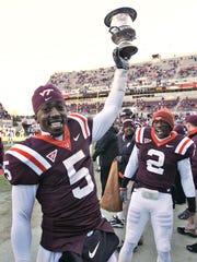 Virginia Tech quarterback Tyrod Taylor (5) holds the