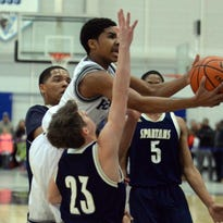 St. Augustine guard Sa'eed Nelson drives past Holy Sprit's Drew Gallagher during Saturday's CAL championship game.