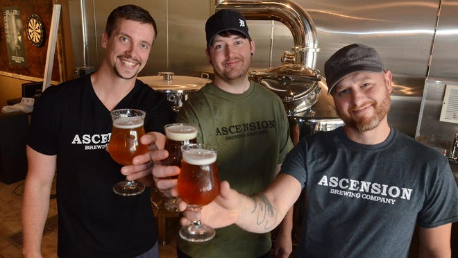 Owners and managers of Novi's Ascension Brewery -- (from left) Adam Czap, Joey Hansen, and Jeremiah Lynch -- raise a glass to their July 24 opening at 42000 Grand River Avenue. The brewery and small plates tavern will be located just next to Wasabi, west of Meadowbrook.