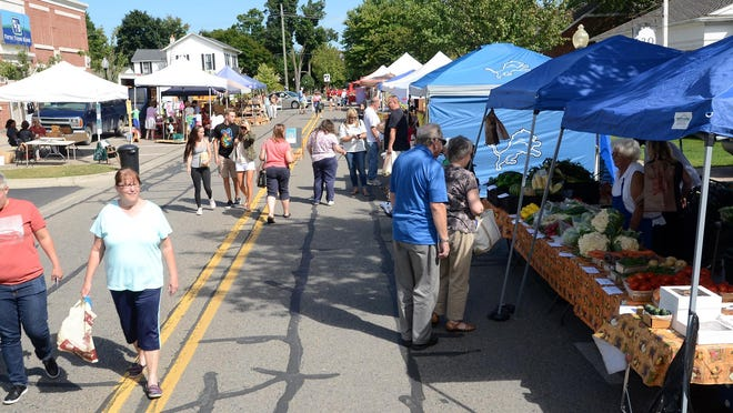 Shoppers take advantage of a near-perfect late summer day to peruse the offerings at the Sept. 10 Milford Farmer's Market.