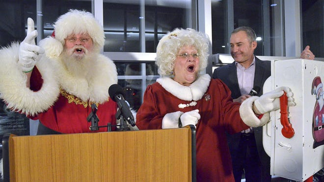 Santa Claus and Westland Mayor William Wild count down to the big moment when Mrs. Claus lights the tree.