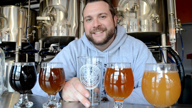 Kevin DeGrood, owner of North Center Brewing Company, in this 2015 file photo. North Center Brewing will move from its current location on North Center Street to space inside the former Village Workshop on East Cady.