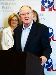 Sen. Lamar Alexander speaks during a unity rally at the Omni Hotel Saturday, Aug. 4, 2018 in Nashville, Tenn. Back left is U.S. Rep. Diane Black.