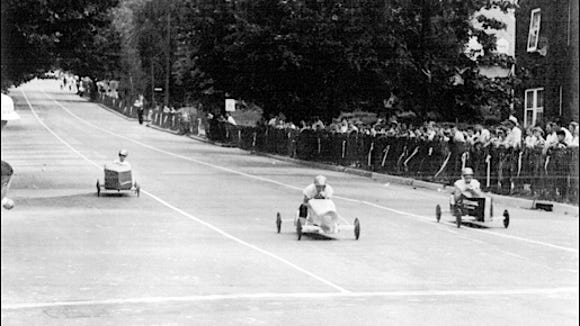Three lanes of Queen Street soap box racers approach the finish line at Irving Road in 1953.  (Source: York County History Center)