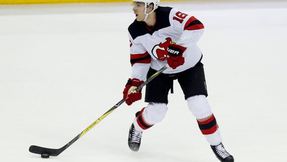 New Jersey Devils defenseman Steven Santini carries