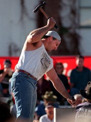 Matt Decker of Stafford, Ariz., pounds his way to a strong finish in the World Championship Single Jack Rock Drilling Contest in Carson City.