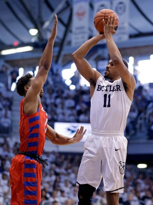 Butler guard Kethan Savage, right, shoots over DePaul guard Eli Cain (11) in the first half of an NCAA college basketball game in Indianapolis, Sunday, Feb. 19, 2017.