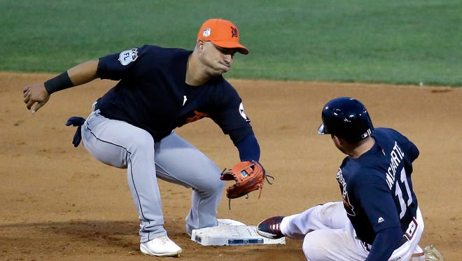 Tigers shortstop Jose Iglesias tags out the Braves' Ender Inciarte on a steal attempt in the sixth inning Thursday, March 23, 2017 in Kissimmee, Fla.